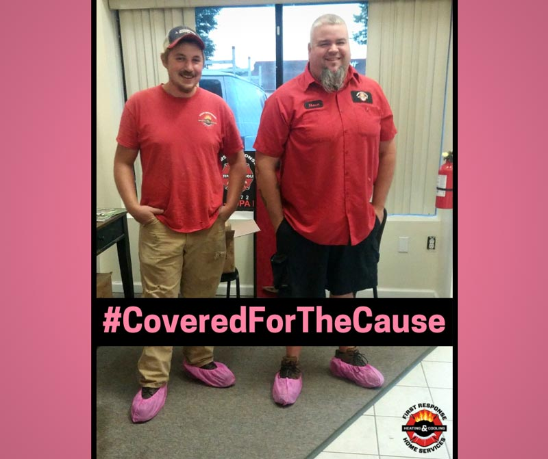 two men wearing pink booties for #CoveredForTheCause